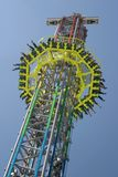 Carnival. Free Fall Tower on a carnival area in bright sunlight royalty free stock photography