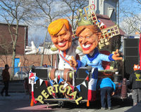Carnival 2014, Aalst. AALST, BELGIUM, MARCH 03 2014: Caricatures of the King and Queen of The Netherlands, during the annual carnival parade in Aalst, which is a Royalty Free Stock Photos