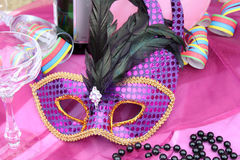 Carnival accessories. Pink party and carnival mask Royalty Free Stock Photography