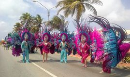 Carnival in Aruba, people in colorful costumes walk in the parade. Colorful costumes display the heritage in the annual Carnival Parade in Aruba royalty free stock photography