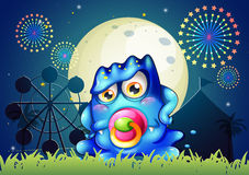 A carnival with a baby blue monster with a pacifier. Illustration of a carnival with a baby blue monster with a pacifier Royalty Free Stock Photos