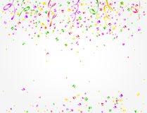 Carnival background with colorful confetti and streamers. Many confetti and streamers of Carnival party on white background with space to put text in the middle Royalty Free Stock Photos