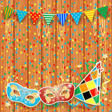 Carnival background with festoon, masks and hat Stock Images