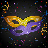 Carnival background. Carnival mask on a black background. EPS 10 Stock Photos