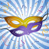 Carnival background. Carnival mask on a blue background with rays. EPS 10 Stock Image