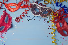 Carnival background with mask, serpantine and confetti. Royalty Free Stock Images