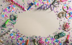 Carnival or birthday party. Confetti and serpentines on pastel grey background. Top view, copy space