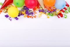 Carnival or birthday party items. Confetti cones balloons and shiny stars white background copy space flat lay stock images