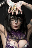 Carnival bizarre woman. Carnival portrait of sexy woman with brown smooth hair, tattoos and bizarre look. Wearing glitter bra, baroque mask and creative jewels Royalty Free Stock Images