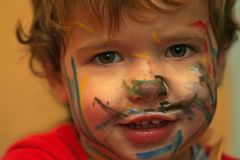 Carnival boy. Closeup face of a boy with painted face Royalty Free Stock Photography