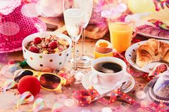 Carnival breakfast with party accessories Stock Photo
