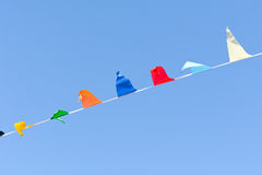 Carnival bunting flags fluttering in the wind Royalty Free Stock Images
