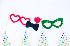 Carnival caps and funny masks on a white background isolated. Party tools and decoration. Happy birthday layout. Purim. Design. Concept. Select focus, Copy royalty free stock images