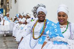 Carnival celebration at Pelourinho in Salvador Bahia, Brazil. Salvador Bahia, Brazil - February 12th, 2018: portrait of a two women with candomble costume royalty free stock photo