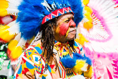 Carnival chief. Male masquerader in a colorful indian costume during Carnival Tuesday celebrations in Port Of Spain Trinidad Royalty Free Stock Images