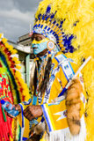 Carnival chief yellow. Masquerader in a colorful indian costume at Trinidad Carnival Tuesday celebrations in Port Of Spain Trinidad Royalty Free Stock Image
