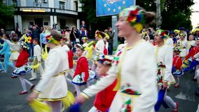 Carnival, children in traditional Ukrainian costumes, go through the city streets, the girls in floral wreath, joyful. Kherson, Ukraine 20 May 2016: Festival stock video footage
