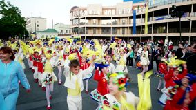 Carnival in the city, the children at the carnival, pupils, boys and girls in Ukrainian national costumes happily. Kherson, Ukraine 20 May 2016: Festival stock footage