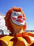Carnival Clown. This clown statue stands ready to greet visitors at a country carnival Stock Images