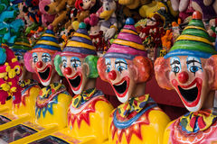 Carnival clown heads in side show alley Stock Image
