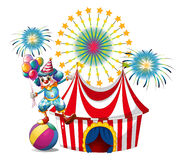 A carnival with a clown holding balloons. Illustration of a carnival with a clown holding balloons on a white background Royalty Free Stock Image