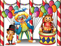 A carnival with a clown and monkeys Royalty Free Stock Photo
