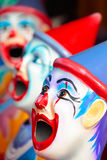 Carnival clowns. Side show carnival clowns with mouths open ready for play Stock Image