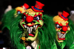 Carnival Clowns. Colourful Macabre Masked Carnival Clowns Stock Image