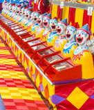 Carnival clowns. Row of Carnival Clowns on a side show at Sydney Royal Easter show. Copyspace Royalty Free Stock Photo