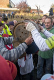 A carnival committee members puts a tar barrel Royalty Free Stock Photography