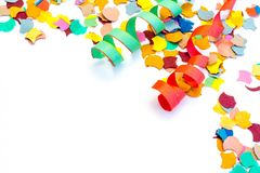 Carnival confetti streamers isolated on white background royalty free stock photography