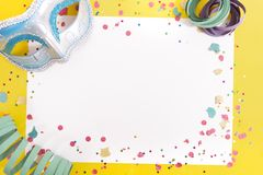 Carnival confetti on white paper royalty free stock photos