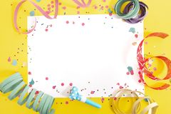 Carnival confetti on white paper royalty free stock photo