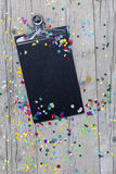 Carnival confetti on wood background Stock Photos