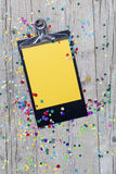 Carnival confetti on wood background Stock Photography