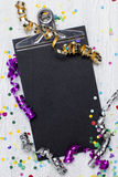 Carnival confetti on wood background Stock Images