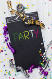 Carnival confetti on wood background Stock Image