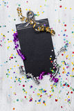Carnival confetti on wood background Royalty Free Stock Image