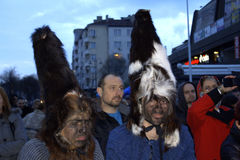 Carnival costumed people. Spectacular costumed kukeri and citizens enjoying the Spring Carnival held on March 26th 2016,Varna Bulgaria Stock Photography
