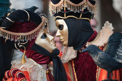 Carnival couple. In Venice waiting to kiss