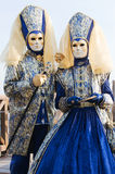 Carnival couple. Beautiful carnival couple in blue and yellow outfit
