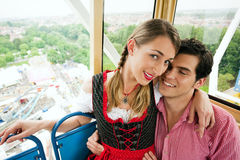 Carnival couple - Ferris wheel Stock Photos