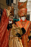 Carnival Couple in Orange Costumes, Venice Stock Images