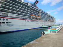 The Carnival Cruise ship Legend docked at Ocho Rios Jamaica. The Carnival Legend docked at Ocho Rios Jamaica for an excursion on Mystic Mountain stock photo