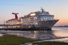 Cruise Ship Charleston SC Harbor. This Carnival cruise ship was loading supplies and making preparations to depart around sunrise in the Charleston, South Royalty Free Stock Images