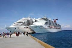 Carnival cruise ships. Two Carnival cruise ships docked in Cozumel, Mexico in November Stock Images