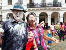 Carnival in Cuenca, Ecuador. Couple with a lot of foam on their faces royalty free stock image