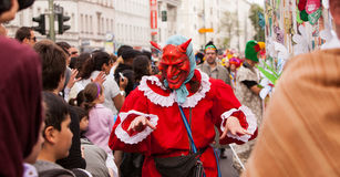 Carnival of Cultures (Berlin 2010). Participant wearing devil masks at the Carnival of Cultures Royalty Free Stock Image
