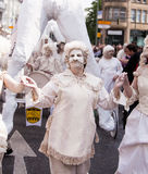 Carnival of Cultures (Berlin 2010). Participants at the Carnival of Cultures dressed in white and covered in clay Royalty Free Stock Image