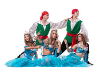 Carnival dancer team dressed as mermaids and pirates.  Isolated on white background in full length. Stock Image